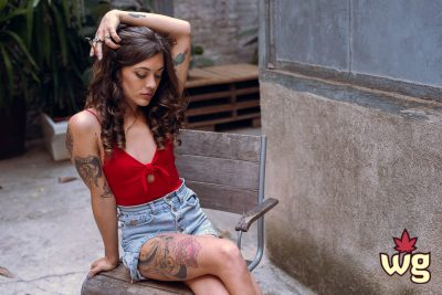 sexy tattoo model wearing red bodysuit and smoking weed | weed girls